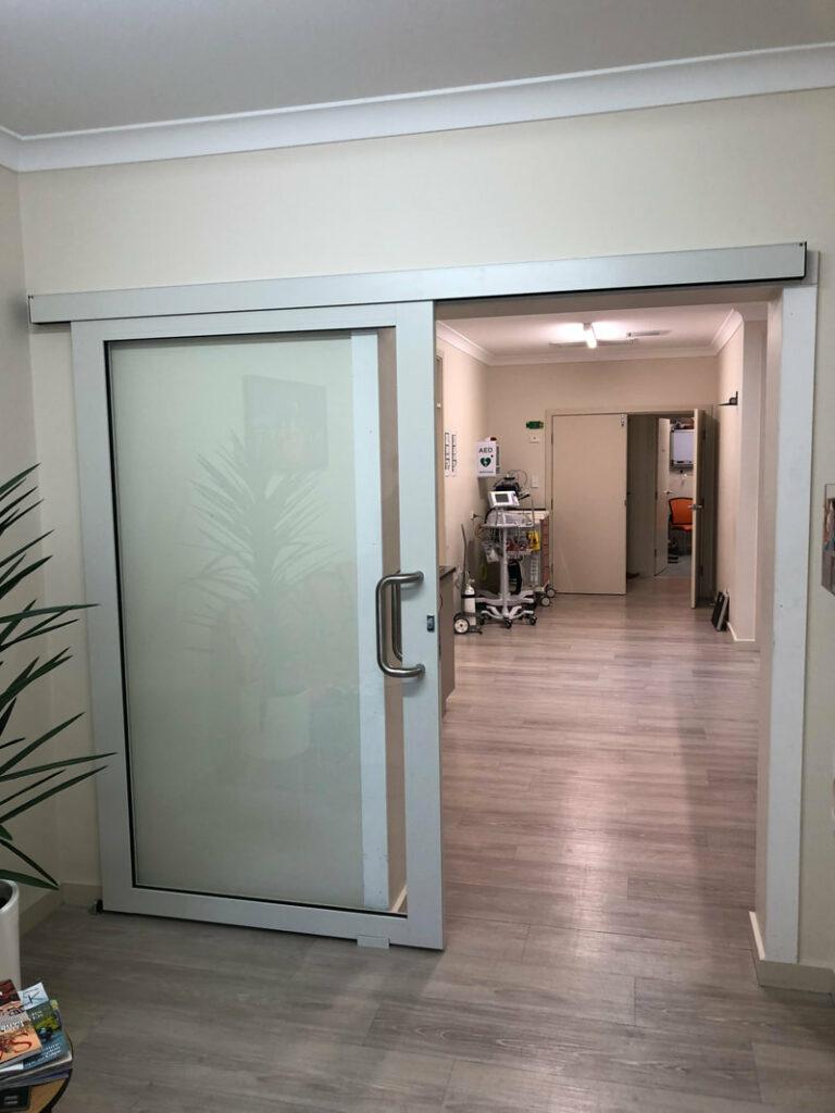 Nu-View Aluminium Windows, Doors & Glass - Internal Commercial sliding door