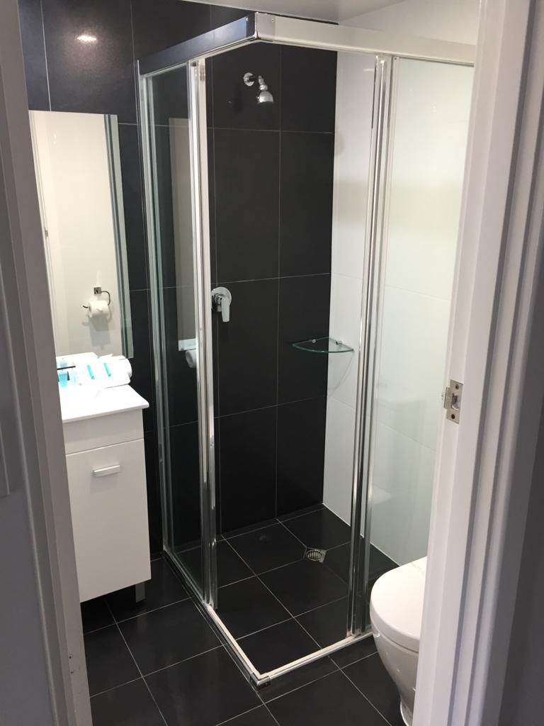 Nu-View Aluminium Windows, Doors & Glass - Fully Framed Silver Shower Corner Opening