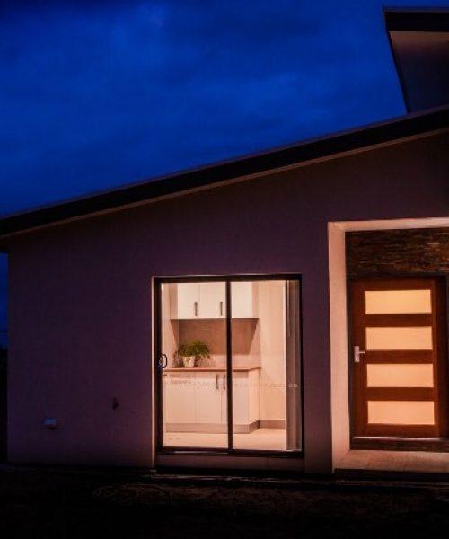 Nu-View Aluminium Windows, Doors & Glass - Sliding Doors at Night